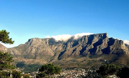 Table Mountain is a flat-topped mountain forming a prominent landmark overlooking the city of Cape Town in South Africa, and is featured in the flag of Cape Town and other...