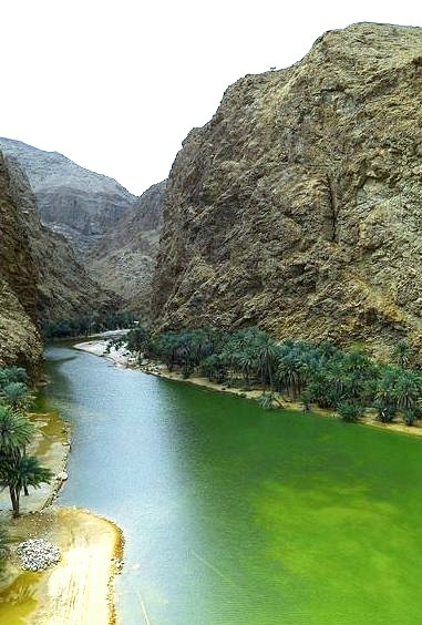 Emerald green waters of Wadi Shab in Oman