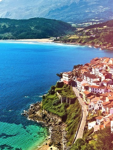 """View from the San Roque viewpoint of the fishing village of Lastres, Asturias, Spain .]]>"""" id=""""IMAGE-mdkw0bIJu41r6b8aao1_500″ /></a></p><p>View from the San Roque viewpoint of the fishing village of Lastres, Asturias, Spain .]]><br />#pueblo, #village, #playa, #sailor, #spain</p></div><footer class="""