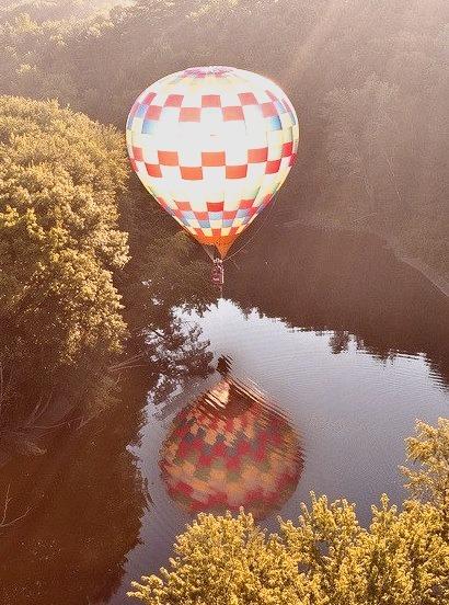 Hot-air balloon reflected in a river near Hillsborough, New Hampshire, USA